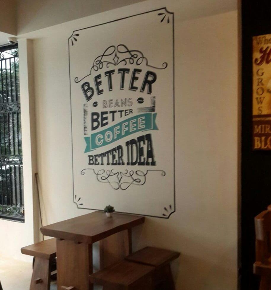 """Mural Tipografi di Doppio Coffee """"Better Beans, Better Coffee, Better Idea"""""""